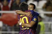 Alexis Sanchez (R) of FC Barcelona celebrates with team mate Lionel Messi after scoring during the La Liga match between Rayo Vallecano and FC Barcelona at Estadio Teresa Rivero on April 29, 2012 in Madrid, Spain.