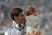 Real Madrid player Gareth Bale holds his daughter during the Real Madrid celebration the day after winning the UEFA Champions League final at Santiago Bernabeu Stadium on May 25, 2014 in Madrid, Spain. Real Madrid CF achieves their tenth European Cup at Lisbon at Lisbon 12 years later.
