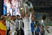 Real Madrid player Gareth Bale lifts the trophy during the Real Madrid celebration the day after winning the UEFA Champions League final at Santiago Bernabeu Stadium on May 25, 2014 in Madrid, Spain. Real Madrid CF achieves their tenth European Cup at Lisbon at Lisbon 12 years later.