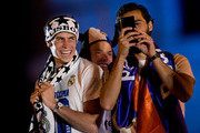 Gareth Bale (L) of Real Madrid CF looks to his teammate Alvaro Arbeloa (R) in presence of Asier Illarramendi (2ndL) during the celebration of their victory on the UEFA Champions League Final match against Club Atletico de Madrid at Cibeles square on the early morning of May, 25, 2014 in Madrid, Spain. Real Madrid CF achieves their 10th European Cup at Lisbon 12 years later.