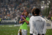 Real Madrid goal keeper Iker Casillas holds his son during the Real Madrid celebration the day after winning the UEFA Champions League final at Santiago Bernabeu Stadium on May 25, 2014 in Madrid, Spain. Real Madrid CF achieves their tenth European Cup at Lisbon at Lisbon 12 years later.