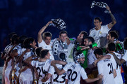 Gareth Bale (2nd L) celebrates with teammates Fabio Coentrao (L), Angel Di Maria (R) and Nacho Fernandez (2nd R) during the Real Madrid celebration the day after winning the UEFA Champions League Final at Santiago Bernabeu stadium on May 25, 2014 in Madrid, Spain. Real Madrid CF achieves their 10th European Cup at Lisbon 12 years later.
