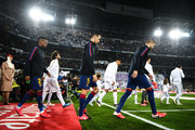 Nelson Semedo, Gerard Pique and Sergio Busquets of FC Barcelona walk onto the pitch during the Liga match between Real Madrid CF and FC Barcelona at Estadio Santiago Bernabeu on March 01, 2020 in Madrid, Spain.