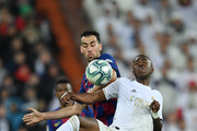 Vinicius Junior of Real Madrid and Sergio Busquets of FC Barcelona battle for the ball in the air during the Liga match between Real Madrid CF and FC Barcelona at Estadio Santiago Bernabeu on March 01, 2020 in Madrid, Spain.