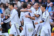 Gonzalo Higuain of Real Madrid CF celebrates scoring their first goal with teammates Cristiano Ronaldo (L), Sergio Ramos (2ndL), Pepe (2ndR) and Mezut Ozil (R) during the La Liga match between Real Madrid CF and RC Deportivo La Coruna at Bernabeu on October 20, 2012 in Madrid, Spain.