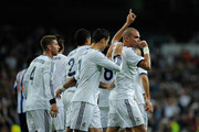 Pepe of Real Madrid CF celebrates scoring his team's fourth goal with team-mates Cristiano Ronaldo and Sergio Ramos (L) during the La Liga match between Real Madrid CF and RC Deportivo La Coruna at Bernabeu on September 30, 2012 in Madrid, Spain.