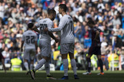 Cristiano Ronaldo (R) of Real Madrid CF clashes hands with Jese Rodriguez (L) as the last one leaves the pitch during the La Liga match between Real Madrid CF and SD Eibar at Estadio Santiago Bernabeu on April 9, 2016 in Madrid, Spain.