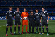 Iker Casillas of Real Madrid CF and teammates James Rodriguez, Xabi Alonso, Gareth Bale, and Marcelo of Real Madrid with designer Yohji Yamamoto during the Adidas 3rd kit launch at Bernabeu on August 26, 2014 in Madrid, Spain.