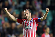 Diego Godin of Atletico Madrid celebrates victory during the UEFA Super Cup between Real Madrid and Atletico Madrid at Lillekula Stadium on August 15, 2018 in Tallinn, Estonia.