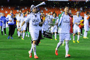 Real Madrid CF players Pepe (L) and Sergio Ramos celebrate with the trophy after winning the Copa del Rey Final between Real Madrid and FC Barcelona at Estadio Mestalla on April 16, 2014 in Valencia, Spain.