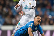 Sergio Ramos of Real Madrid fouls Faycal Fajr of Getafe during the La Liga match between Real Madrid and Getafe at Estadio Santiago Bernabeu on March 3, 2018 in Madrid, Spain.
