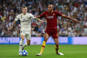 Toni Kroos of Real Madrid is challenged by Steven N'Zonzi of AS Roma during the Group G match of the UEFA Champions League between Real Madrid  and AS Roma at Bernabeu on September 19, 2018 in Madrid, Spain.