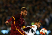 Daniele De Rossi of AS Roma and Jese Rodriguez of Real Madrid contest the ball during the International Champions Cup friendly match between Real Madrid and AS Roma at the Melbourne Cricket Ground on July 18, 2015 in Melbourne, Australia.