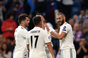 Karim Benzema of Real Madrid celebrates with teammates after scoring his team's first goal during the Group G match of the UEFA Champions League between Real Madrid  and Viktoria Plzen at Bernabeu on October 23, 2018 in Madrid, Spain.