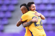 Arturo Vidal of Barcelona celebrates with teammate Lionel Messi after scoring his team's first goal during the Liga match between Real Valladolid CF and FC Barcelona at Jose Zorrilla on July 11, 2020 in Valladolid, Spain. Football Stadiums around Europe remain empty due to the Coronavirus Pandemic as Government social distancing laws prohibit fans inside venues resulting in all fixtures being played behind closed doors.