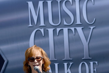 Reba McEntire Faith Hill and Tim McGraw Attend a Nashville Music City Walk of Fame Induction Ceremony