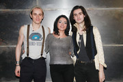 """Reeve Carney (L) and Zane Carney (R) of the rock band Carney pose for photos with host Juliya Chernetsky (C) during a taping of """"Fuse's Top 20 Countdown"""" at fuse Studios on March 17, 2011 in New York City.  This episode airs March 22 at 5pm ET."""