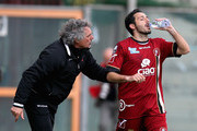Giuseppe Pillon (L) head coach of Reggina speaks with his player David Di Michele during the Serie B match between Reggina Calcio and SS Juve Stabia at Stadio Oreste Granillo on March 24, 2013 in Reggio Calabria, Italy.