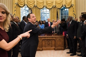 Reince Priebus Trump Aide Kellyanne Conway Draws Ire for Kneeling on White House Sofa