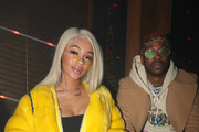 Saweetie (L) and 2 Chainz attend as Remy Martin presents Beats Party on February 17, 2018 in Los Angeles, California.