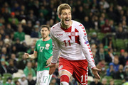 Denmark's striker Nicklas Bendtner celebrates after scoring their fifth goal from the penalty spot during the FIFA World Cup 2018 qualifying football match, second leg, between Republic of Ireland and Denmark at Aviva Stadium in Dublin on November 14, 2017..Christian Eriksen scored a magnificent hat-trick to seal Denmark's place at next year's World Cup after a 5-1 win over the Republic of Ireland in their play-off second leg in Dublin. / AFP PHOTO / Paul FAITH