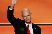 Florida Governor Rick Scott waves to the crowd after delivering a speech on the third day of the Republican National Convention on July 20, 2016 at the Quicken Loans Arena in Cleveland, Ohio. Republican presidential candidate Donald Trump received the number of votes needed to secure the party's nomination. An estimated 50,000 people are expected in Cleveland, including hundreds of protesters and members of the media. The four-day Republican National Convention kicked off on July 18.