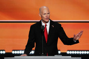 Florida Governor Rick Scott gestures as he delivers a speech on the third day of the Republican National Convention on July 20, 2016 at the Quicken Loans Arena in Cleveland, Ohio. Republican presidential candidate Donald Trump received the number of votes needed to secure the party's nomination. An estimated 50,000 people are expected in Cleveland, including hundreds of protesters and members of the media. The four-day Republican National Convention kicked off on July 18.