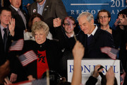 Republican presidential candidate, U.S. Rep. Ron Paul (R-TX), and his wife Carol Paul wave to supporters at his primary night campaign rally on January 10, 2012 in Manchester, New Hampshire. According to early results, Paul finished second behind former Massachusetts Gov. Mitt Romney in the first in the nation primary.