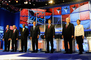 (L-R) U.S. Sen. Rick Santorum (R-PA), U.S. Rep. Ron Paul (R-TX), former CEO of Godfather's Pizza Herman Cain, former Massachusetts Gov. Mitt Romney, Texas Gov. Rick Perry, Former Speaker of the House Newt Gingrich and U.S. Rep. Michele Bachmann (R-MN) are introduced at the Republican presidential debate airing on CNN, October 18, 2011 in Las Vegas, Nevada. Seven GOP contenders are taking part in the debate, which is sponsored by the Western Republican Leadership Conference in Las Vegas and held in the Venetian Hotel's Sands Expo and Convention Center.