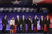 Republican presidential candidates (L to R) former U.S. Senator from Pennsylvania Rick Santorum, U.S. Representative Michele Bachmann (R-MN), former Speaker of the House Newt Gingrich, former Massachusetts Governor Mitt Romney, businessman Herman Cain, Texas Governor Rick Perry, U.S. Representative Ron Paul (R-TX), and former Utah Governor Jon Huntsman stand on stage prior to the start of a debate hosted by CNBC and the Michigan Republican Party at Oakland University on November 9, 2011 in Rochester, Michigan. The debate is the first meeting of the eight GOP presidential hopefuls since allegations of sexual impropriety have surfaced against front-runner Herman Cain.