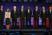 Republican presidential candidates (L to R) former U.S. Senator from Pennsylvania Rick Santorum, U.S. Representative Michele Bachmann (R-MN), former Speaker of the House Newt Gingrich, former Massachusetts Governor Mitt Romney, businessman Herman Cain, Texas Governor Rick Perry,  U.S. Representative Ron Paul (R-TX), and former Utah Governor Jon Huntsman, are introduced at a debate hosted by CNBC and the Michigan Republican Party at Oakland University on November 9, 2011 in Rochester, Michigan. The debate is the first meeting of the eight GOP presidential hopefuls since allegations of sexual impropriety have surfaced against front-runner Herman Cain.