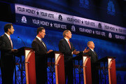 Republican  presidential candidate George Pataki (2nd R)) speaks while  Sen. Lindsey Graham (R) (R-SC) Rick Santorum (2nd L) and Louisiana Gov. Bobby Jindal look on during the CNBC Republican Presidential Debate at University of Colorado's Coors Events Center October 28, 2015 in Boulder, Colorado.  Fourteen Republican presidential candidates are participating in the third set of Republican presidential debates.
