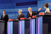 (AFP OUT)  Republican presidential candidates from left, former Massachusetts Gov. Mitt Romney, former House Speaker Newt Gingrich, Rep. Ron Paul, (R-TX), and Rep. Michele Bachmann, (R-MN),  participate in a Republican presidential debate at the Sioux City Convention Center on December 15, 2011 in Sioux City, Iowa. The GOP contenders are in the final stretch of campaigning in Iowa where the January 3rd caucus is the first test the candidates must face before becoming the Republican presidential nominee.
