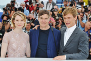 """(L-R) Mia Wasikowska, director Gus Van Sant and Henry Hopper attend the """"Restless"""" photocall during the 64th Annual Cannes Film Festival on May 13, 2011 in Cannes, France."""