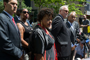 (L-R) Ellisha Garner; Gwen Carr, mother of the late Eric Garner; family attorney Jonathan Moore and Rev. Al Sharpton listen to questions from the press after meeting with Department of Justice officials, June 21, 2017 in the Brooklyn borough of New York City. The family was expected to receive a status report on the progress of the civil rights investigation into Eric Garner's police-involved choking death.