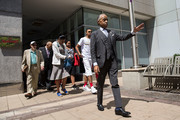 Rev. Al Sharpton, trailed by family members of the late Eric Garner, exit the Brooklyn Marriott after meeting with Department of Justice officials, June 21, 2017 in the Brooklyn borough of New York City. The family was expected to receive a status report on the progress of the civil rights investigation into Eric Garner's police-involved choking death.