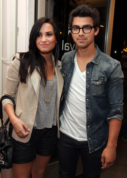 Demi Lovato and Joe Jonas attend the grand opening of Revival Vintage on April 28, 2010 in Los Angeles, California.