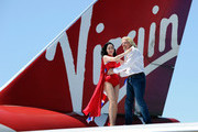 Burlesque artist Dita Von Teese (L) and Founder and President of Virgin Group Sir Richard Branson appear on the wing of a Virgin Atlantic Airways 747-400 aircraft at McCarran International Airport June 15, 2010 in Las Vegas, Nevada. Branson is celebrating his British airline's 10th anniversary of flying between London and Las Vegas.