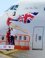 Burlesque artist Dita Von Teese (L) and Founder and President of Virgin Group Sir Richard Branson appear on a lift in front of a painting of Von Teese on the side of a Virgin Atlantic Airways 747-400 aircraft at McCarran International Airport June 15, 2010 in Las Vegas, Nevada. Branson is celebrating his British airline's 10th anniversary of flying between London and Las Vegas.
