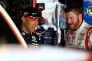Matt Kenseth (L), driver of the #20 Home Depot Husky Toyota, talks to Dale Earnhardt Jr., driver of the #88 National Guard Chevrolet, during practice for the NASCAR Sprint Cup Series Toyota Owners 400 at Richmond International Raceway on April 25, 2014 in Richmond, Virginia.