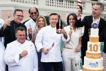 Rick Moonen Chef Daniel Boulud Sabers Off A Bottle of Prosecco Celebrating Vegas Uncork'd By Bon Appetit's 10th Anniversary