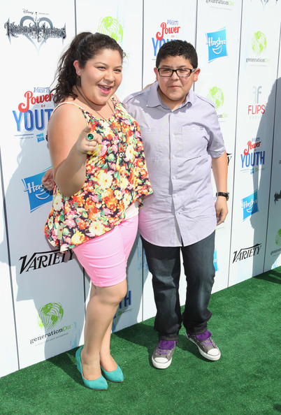 Rico Rodriguez (L-R) Actors Raini Rodriguez and Rico Rodriguez attend Variety's Power of Youth presented by Hasbro and GenerationOn at Universal Studios Backlot on July 27, 2013 in Universal City, California.