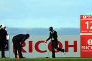 Cristie Kerr of the United States and Suzann Pettersen of Norway in discussion with LPGA referee Bo Ream of the United States on the 12th tee as Kerr's ball fell off the tee a number of times due to high winds during the second round of the 2012 Ricoh Women's British Open at Royal Liverpool on September 14, 2012 in Hoylake, England.