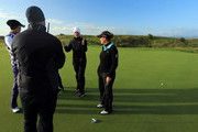 Suzzann Pettersen of Norway (second from right), Cristie Kerr of the United States (r) and Michelle Wie of the United States (l) in consultation with LPGA Tour referee Bo Ream about her ball that was oscillating on the spot due to high winds on the 12th green, play was suspended shortly after during the second round of the 2012 Ricoh Women's British Open at Royal Liverpool on September 14, 2012 in Hoylake, England.