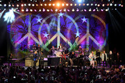 Ringo Starr (center) with Joe Walsh, Nils Lofgren, Steve Lukather, Gregg Rollie, Colin Hay, Warren Hamm, Gregg Bissonette, Hamish Stuart and Edgar Winter perform during the Ringo Starr and his All Starr Band concert at The Greek Theatre on September 01, 2019 in Los Angeles, California.