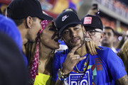 Brazilian football player Neymar (R) attends the parade of the Paraiso do Tuiuti samba school performance during the parade at 2019 Brazilian Carnival at Sapucai Sambadrome on March 04, 2019 in Rio de Janeiro, Brazil. Rio's two nights of Carnival parades began on March 03 in a burst of fireworks and to the cheers of thousands of tourists and locals who have previously enjoyed street celebrations (known as 'blocos de rua') all around the city.