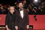 """(L-R) Director Sally Potter and Javier Bardem pose at the """"The Roads Not Taken"""" premiere during the 70th Berlinale International Film Festival Berlin at Berlinale Palace on February 26, 2020 in Berlin, Germany."""
