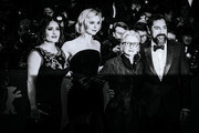 """Image was converted to black and white) (L-R) Salma Hayek, Elle Fanning, director Sally Potter and Javier Bardem pose at the """"The Roads Not Taken"""" premiere during the 70th Berlinale International Film Festival Berlin at Berlinale Palace on February 26, 2020 in Berlin, Germany."""