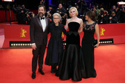 """(L-R) Javier Bardem, director Sally Potter, Elle Fanning and Salma Hayek pose at the """"The Roads Not Taken"""" premiere during the 70th Berlinale International Film Festival Berlin at Berlinale Palace on February 26, 2020 in Berlin, Germany."""