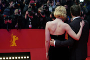 """(L-R) Elle Fanning and Javier Bardem pose at the """"The Roads Not Taken"""" premiere during the 70th Berlinale International Film Festival Berlin at Berlinale Palace on February 26, 2020 in Berlin, Germany."""